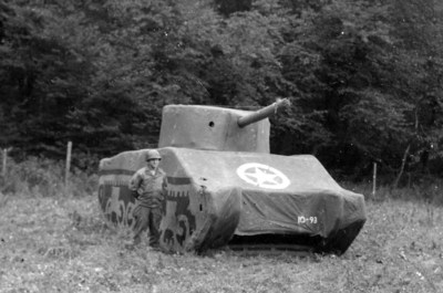 A Ghost Army soldier with an dummy M4 Sherman Tank, 93 pounds fully inflatable, September 1944, France. Courtesy: National Archives.
