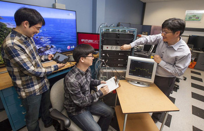 In LG's U.S. R&D Lab in Lincolnshire, Ill., engineers from the LG Creative Innovation Center in Seoul (left to right) Jin Woo Kim, Woo Chan Kim and Sung Kyong Hong evaluate the first closed circuit FUTURECAST transmission, allowing Ultra HD, mobile, and fixed reception in a single 6 MHz channel.  (PRNewsFoto/LG Electronics USA)