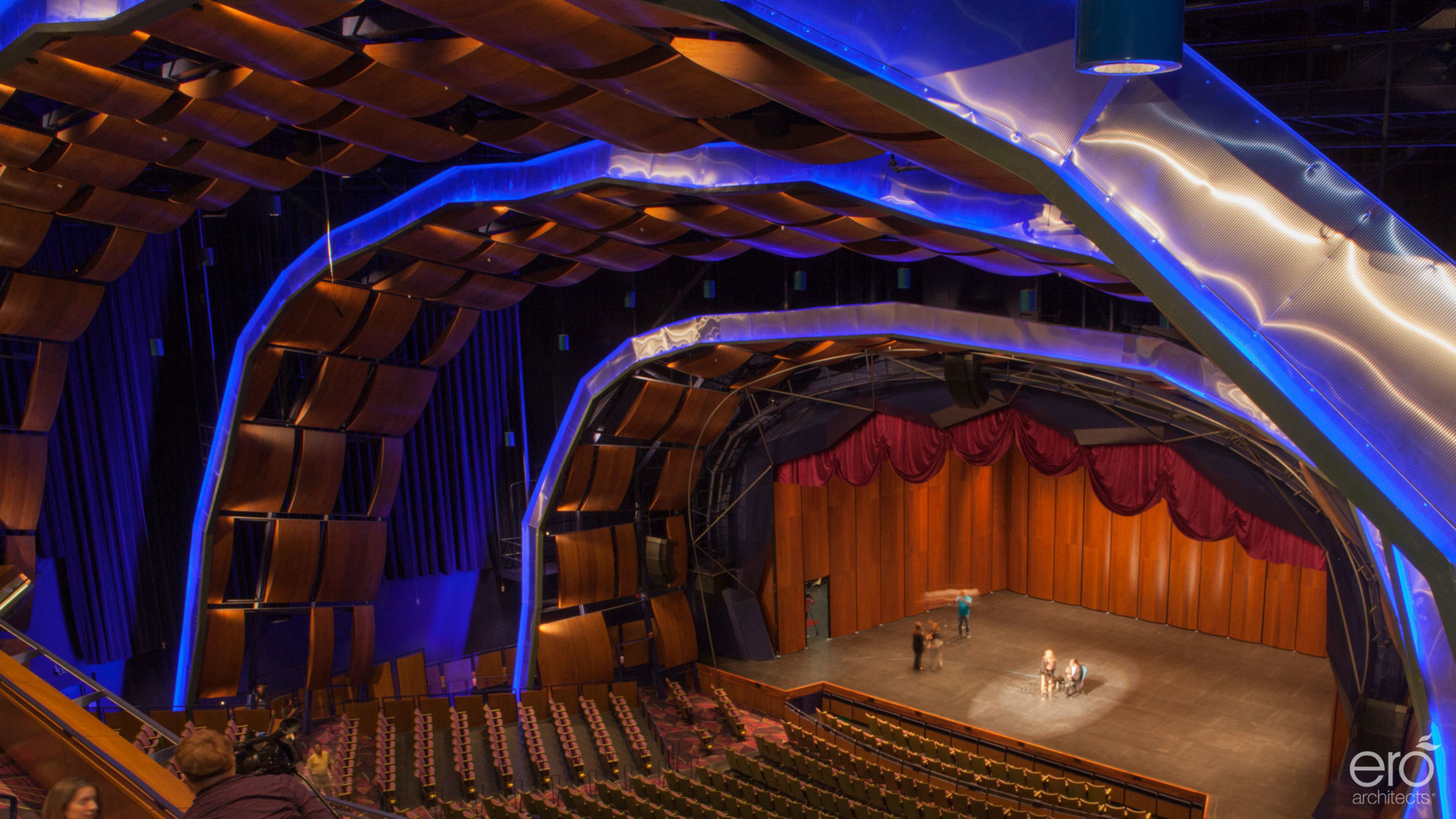 The stage of the McAllen Peforming Arts Center, designed by ERO Architects, amazes the eye. At more than eight stories tall and 1½ times the size of a professional basketball court, the audience feels the immensity of a space that could contain the volume of 20 Olympic-sized swimming pools. Computer programs adjust more than 10,000 square feet of acoustic fabric on the walls and ceiling to accentuate the sounds of the Valley Symphony or Broadway musical troupes. The interior arches are solid pecan wood...