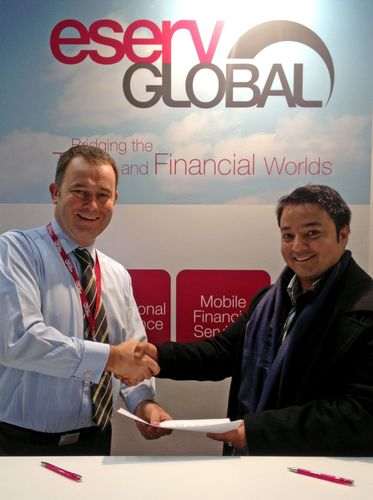 eServGlobal CFO and Finance Director, Stephen Blundell with MNepal Board Director, Mangesh Lal Shrestha (PRNewsFoto/eServGlobal)
