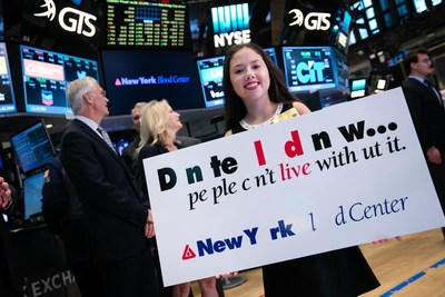 Lauren Shields holds the #MissingType sign during the New York Blood Center's ringing of the opening bell at the New York Stock Exchange on Tuesday, August 9th.