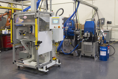 Henkel's new high-pressure Resin Transfer Molding (RTM) system enables automotive OEMs and suppliers to test the viability of carbon-fiber and glass-fiber composites with Henkel's Loctite(R) MAX Series for future applications. Henkel's RTM system is believed to be the first high-pressure RTM system for a two-component polyurethane in the United States.  (PRNewsFoto/Henkel)