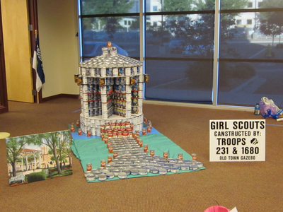 At the recent Canstruction competition, Troops 231 and 1680 of the Girl Scouts of New Mexico Trails built their award-winning replica of the Old Town gazebo with the help of Steve Harris, P.E., of Renaissance Engineering LLC. The annual event was held at CH2M HILL's Albuquerque office.  (PRNewsFoto/CH2M HILL)