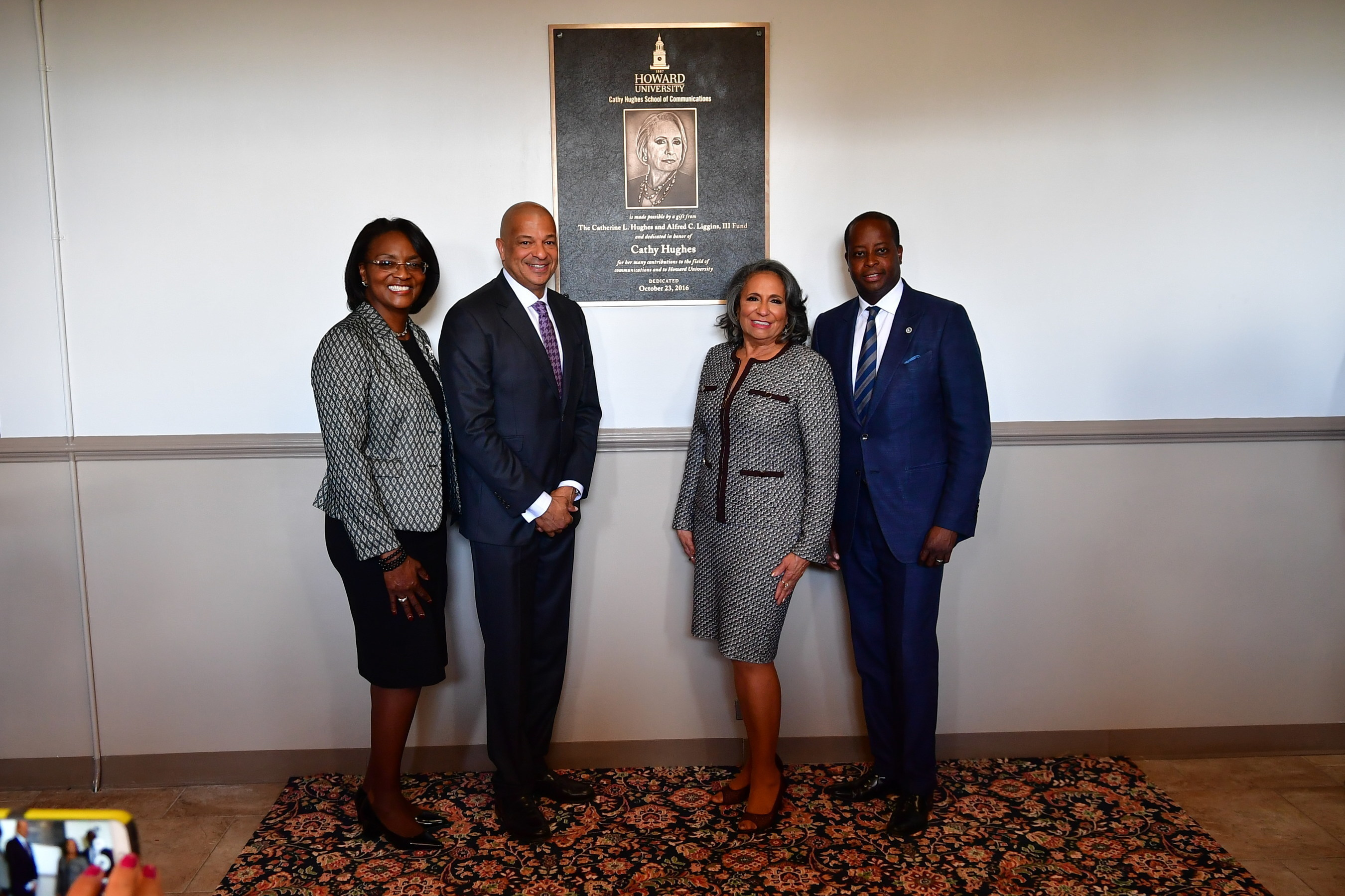 Dean of Cathy Hughes School of Communications Gracie Lawson-Borders, Ph. D, Radio One, Inc. CEO and President Alfred C. Liggins, III, Radio One, Inc. Founder and Chairperson Cathy Hughes and Howard University President Dr. Wayne A.I. Frederick at the Cathy Hughes School of Communications unveiling ceremony at Howard University on Sunday, October 23, 2016 in Washington.