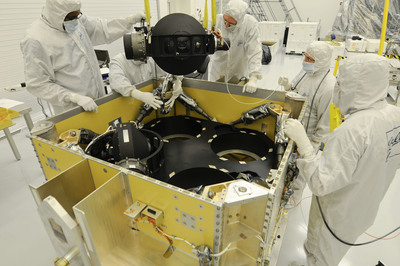 Ball Aerospace technicians install the control moment gyroscopes for DigitalGlobe's WorldView-3 remote sensing satellite.  (PRNewsFoto/Ball Aerospace & Technologies Corp.)