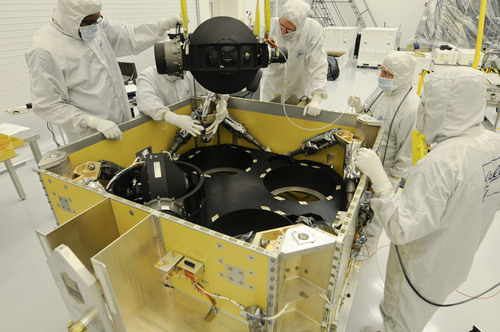 Ball Aerospace technicians install the control moment gyroscopes for DigitalGlobe's WorldView-3 remote ...