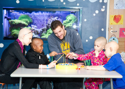 While visiting the kids of St. Jude Children's Research Hospital, David Lee, St. Jude Hoops Ambassador and player for the Golden State Warriors, had a blast playing with patients.  (PRNewsFoto/St. Jude Children's Research Hospital)