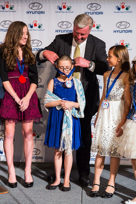 A Pediatric Cancer Fighter Receives a Medal of Recognition from Hyundai Motor America President and CEO Dave Zuchowski