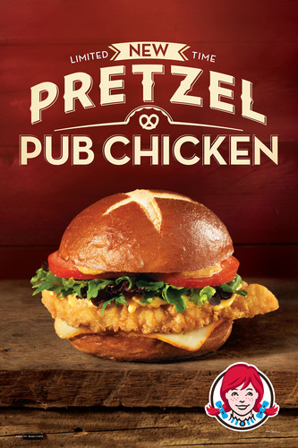 Available for a limited time, Wendy's Pretzel Pub Chicken offers the big flavor of chicken sandwiches found at upscale pubs. The Pretzel Pub Chicken starts with an all-white meat breast fillet, slightly breaded, and is topped with a fresh spring mix and freshly sliced red tomato. A slice of creamy Muenster cheese adds a rich flavor, along with warm cheddar cheese sauce and sweet and savory honey mustard - all enclosed in the artisan-baked, authentic pretzel bun.  (PRNewsFoto/The Wendy's Company)