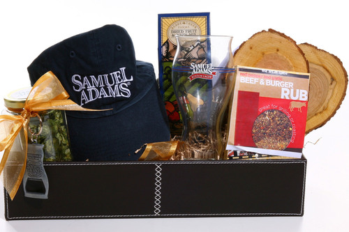 "To help Dad man the grill this Father's Day, Samuel Adams and FromYouFlowers.com are offering the perfect delivery for beer lovers - the Samuel Adams(r) Hoppy Father's Day gift basket.  The present pairs a Samuel Adams Boston Lager(r) Pint Glass with flavored wood grilling planks, a beef spice rub, a Samuel Adams keychain, hat and jar of Noble hop ""flowers;"" all perfectly packaged to enhance the craft beer drinking experience. The gift basket is available in limited quantities for $39.99.  (PRNewsFoto/Samuel Adams)"
