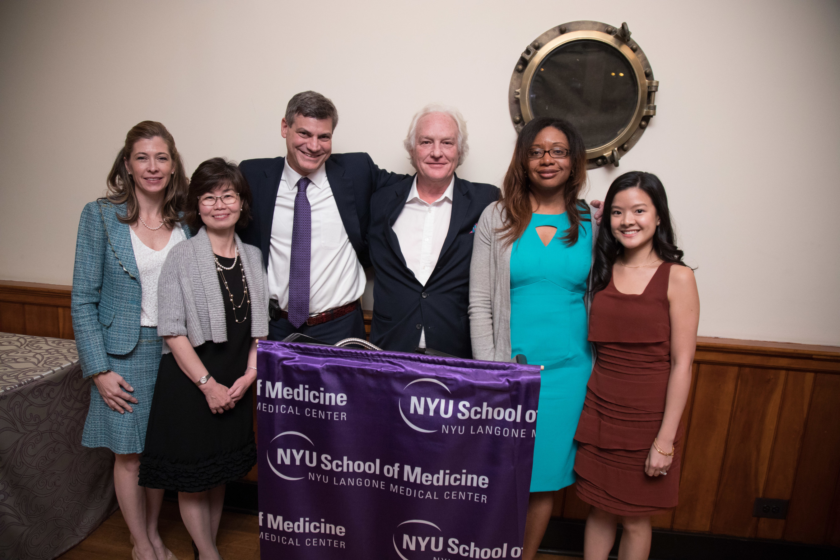 Honorees of the second annual J. Christopher Burch Award for Humanism in Medicine at NYU Langone's Division of Gastroenterology stand with division director Dr. Mark Pochapin and Christopher Burch: [left to right] Carlie Patterson, Jungwon Jun, Renee Williams, and Mabel Liu.