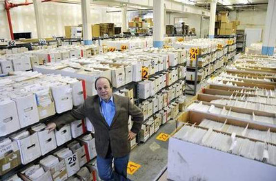 What do 698,117 comic books look like?  Jim Drucker, the CEO of NewKadia.com, the world's largest online-only comic book store stands in front of half of that amount at NewKadia's processing facility.  Most were purchased from collectors selling their comic book collections.  Over 1.1 million people visit the www.NewKadia.com website each year.  (PRNewsFoto/NewKadia.com)