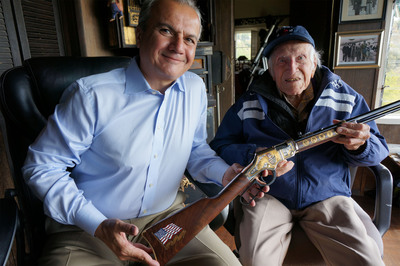 Louis Zamperini, World War II Hero, receiving a custom Henry Military Service Tribute Edition Rifle from Anthony Imperato, President of Henry Repeating Arms. (PRNewsFoto/Henry Repeating Arms) (PRNewsFoto/HENRY REPEATING ARMS)