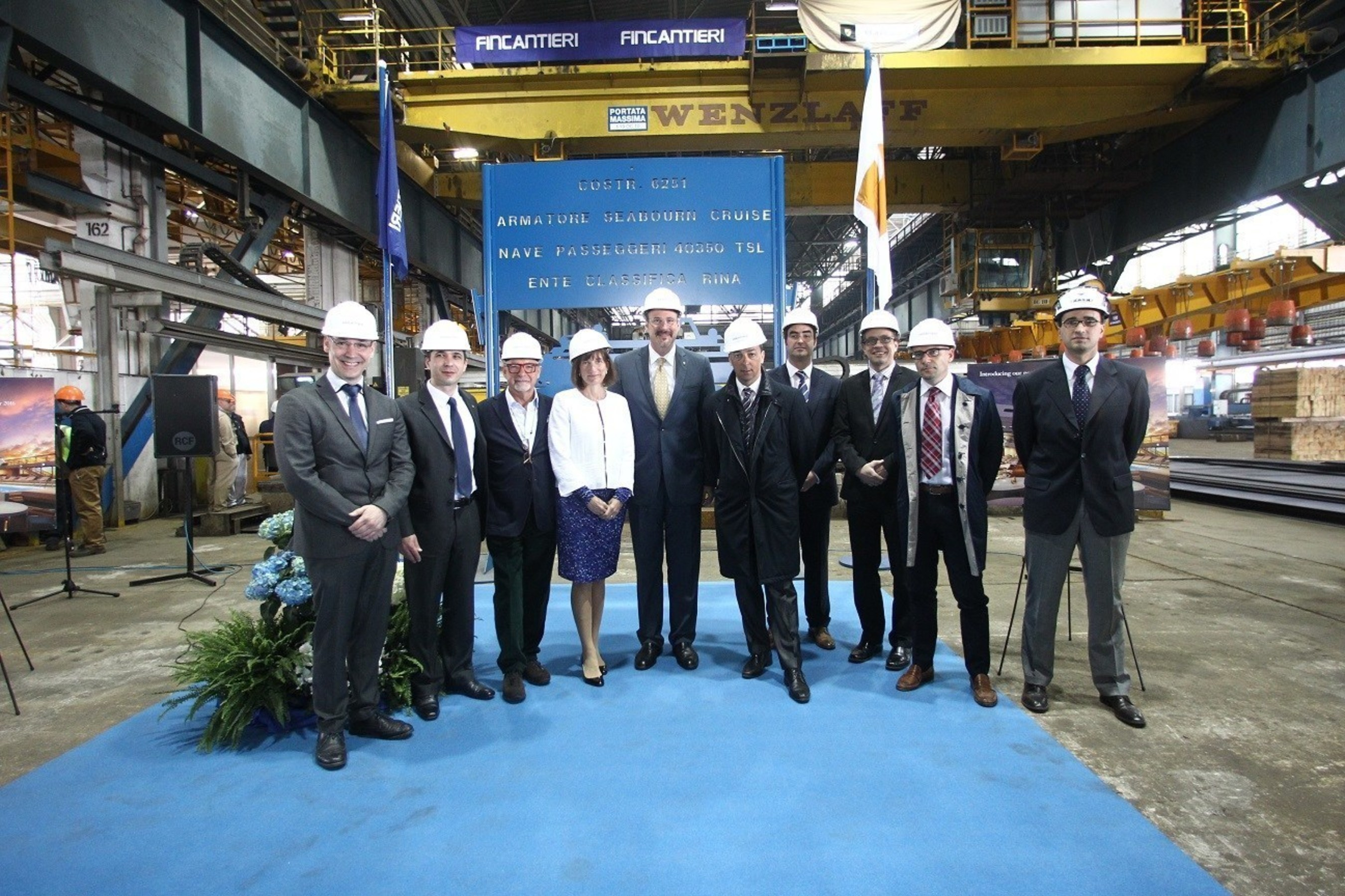 Seabourn celebrated an important milestone today with the cutting of the first steel for Seabourn Encore. Pictured here (left to right):Vitor Alves, Newbuild Project Manager, Seabourn; Cyril Tatar, Vice President of Newbuild and Technical Operations, Seabourn; Adam D. Tihany, Designer for Seabourn Encore, Tihany Design; Marnie Tihany, Director of Business Development, Tihany Design; Richard Meadows, Seabourn President; Antonio Quintano, Director of Fincantieri's Marghera shipyard; James Moore, Corporate...