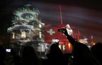 A light installation, created by Swiss light artist Gerry Hofstetter, is projected onto the Royal Observatory in Greenwich, London to mark the launch of a culture project by Swiss International Air Lines (SWISS) and Gerry Hofstetter celebrating personal attentiveness. PRESS ASSOCIATION Photo. Picture date: Wednesday November 26, 2014. Gerry Hofstetter is set to illuminate iconic monuments and buildings in cities across Europe this winter. The project, by SWISS and Gerry, aims to celebrate personal attentiveness. Each installation will feature the eyes of SWISS cabin crew to symbolise eye contact between people and encouraging us all to be more attentive to one another. Photo credit should read: Matt Alexander/PA Wire