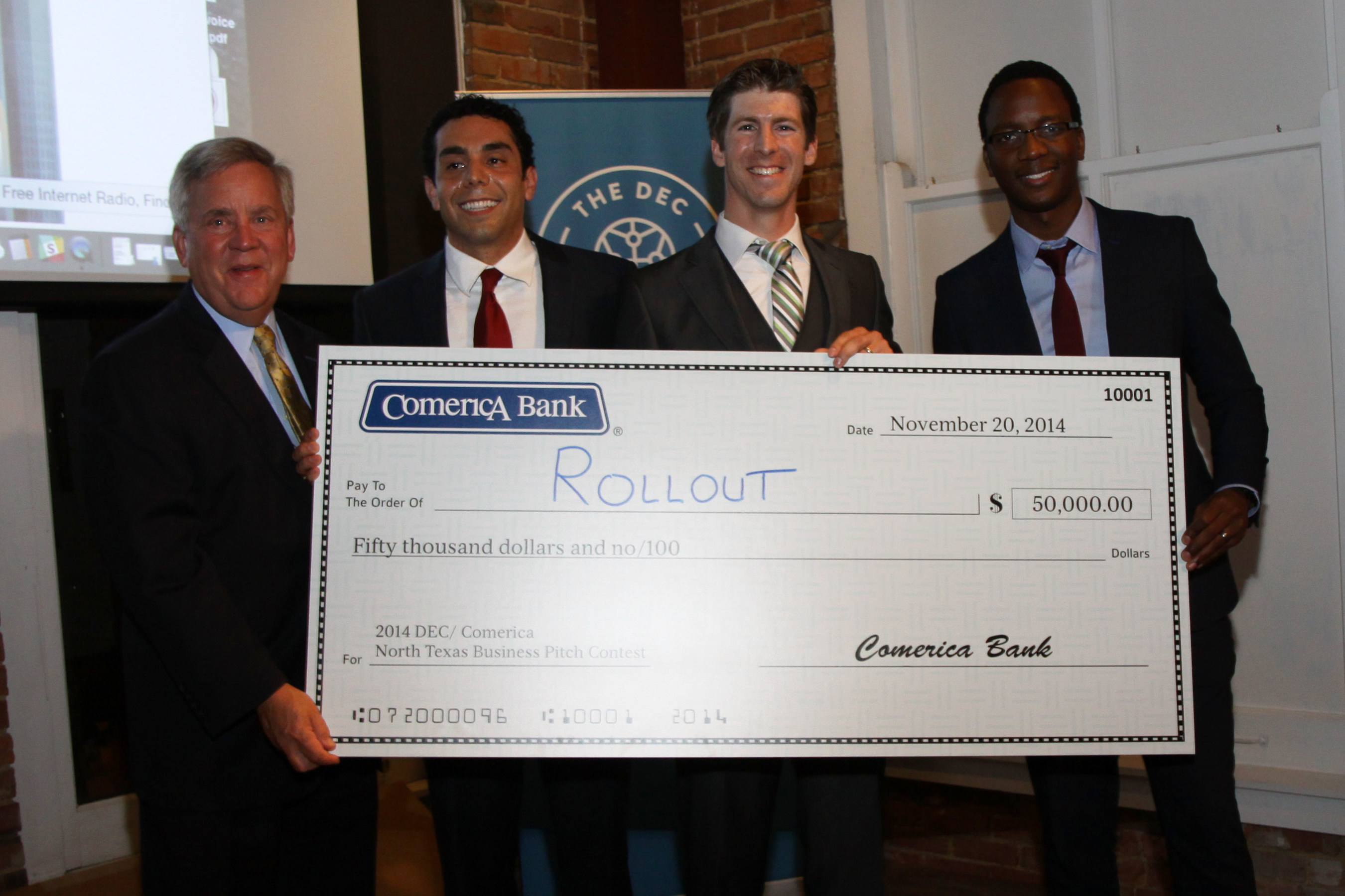 Pat Faubion, Texas Market President for Comerica Bank (far left), presents the $50,000 check to Rollout, Inc., ...