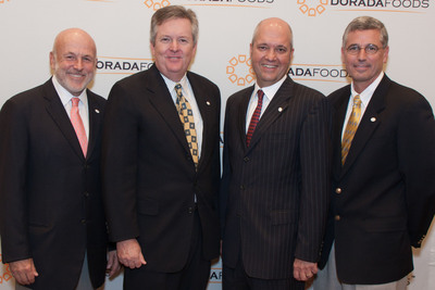 Dorada Poultry and Tyson Foods to open plant in Ponca City, OK. Ed Sanchez, Chairman & CEO (second from right) and Jim English, President & COO (second from left) of Dorada Poultry joined John Tyson, Chairman (left) and Donnie Smith, President & CEO (right) of Tyson Foods, Inc. to announce the opening of the Ponca City facility. The plant, which is expected to employ 350 employees, is scheduled to become operational in mid-2011 and will provide chicken products to McDonald's(R) U.S. restaurants. (PRNewsFoto/Dorada Poultry/Chris Heldenbrand)