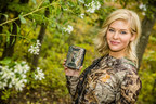 "Former Miss Kansas Theresa Vail using a Kodiak Series Trail Camera in Realtree Xtra camouflage to scout for game animals in the field. Theresa can be seen using Kodiak Series Cameras during her hunting adventures in July 2015 on her show ""Limitless With Theresa Vail"" on the Outdoor Channel."