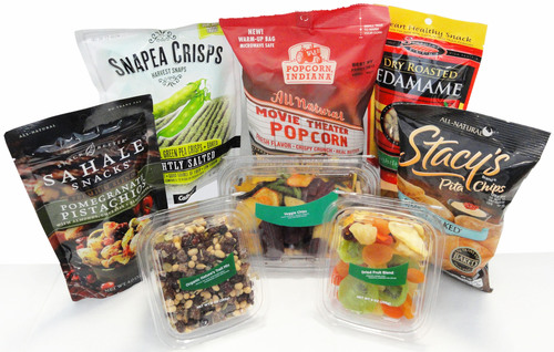 7-Eleven launches an assortment of gourmet, organic and better-for-you packaged snacks that include popular, upscale products along with its new line of 7-Select private-brand snacks packaged in clear plastic containers, all at value prices.  (PRNewsFoto/7-Eleven, Inc.)