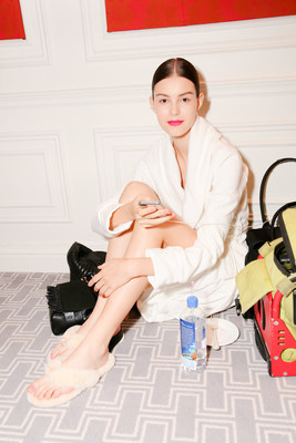 Models wear UGG loungewear and slippers backstage at Marchesa