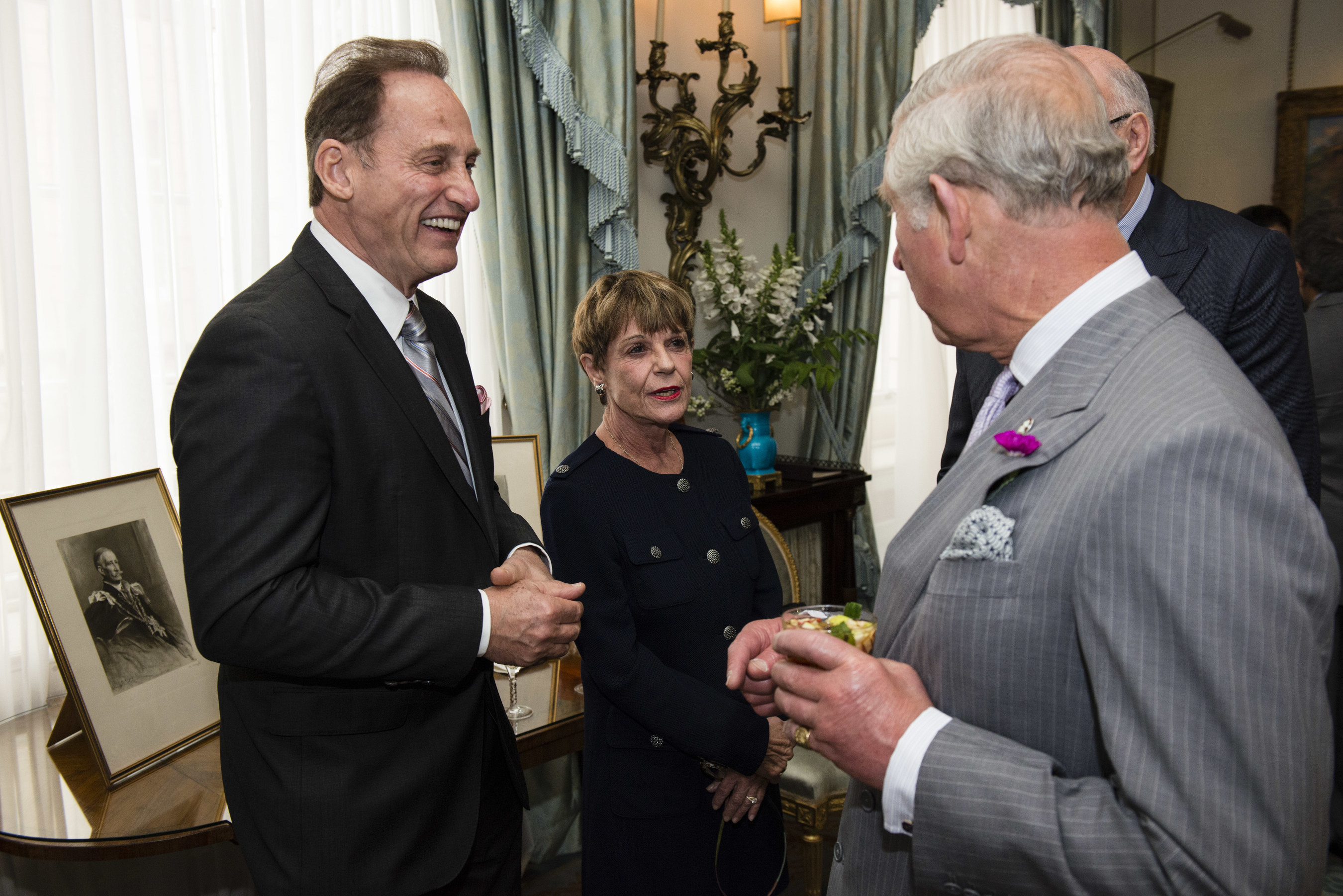 Park West Gallery Founder and CEO Albert Scaglione and his wife, Mitsie, meet with Prince Charles to discuss the Prince's Trust International organization.