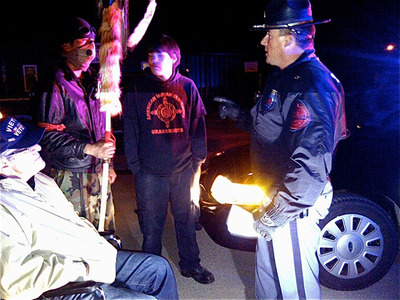 Oglala Sioux Tribal President Bryan Brewer Sr., along with Oglala Native Youth confronted by a Nebraska State Trooper on the Pine Ridge South Dakota Indian Reservation Border - May 1, 2013.  (PRNewsFoto/Alcohol Justice, Nathalie Hand)