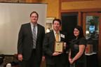Robert Hann, vice president of sales and marketing, GO Airport Express, center, accepts a plaque acknowledging the company's Green Fleet designation by the Illinois EPA in coordination with the Chicago Area Clean Cities coalition.  Also pictured are Darwin Burkhart, (left) program manager for the Illinois EPA and chairman of the Chicago Area Clean Cities Coalition and Samantha Bingham, environmental policy analyst, Chicago Department of Transportation. The award was presented at an event held February 23 in Oak Park, Ill.  (PRNewsFoto/GO Airport Express)