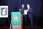 Orange County Sheriff Jerry Demings (l) presents Attorney Dan Newlin (r) with a plaque for his continuous support of the annual Sheriff's Office Community Crime Support. A poster of 20-year-old Tiffany Sessions of Gainesville, FL, missing since February 1989, is displayed. Missing and exploited children was one of the topics discussed at the '2014 Sheriff's Office Community Crime Summit' on September 29, 2014, Orlando, Florida. (PRNewsFoto/Law Offices of Dan Newlin)