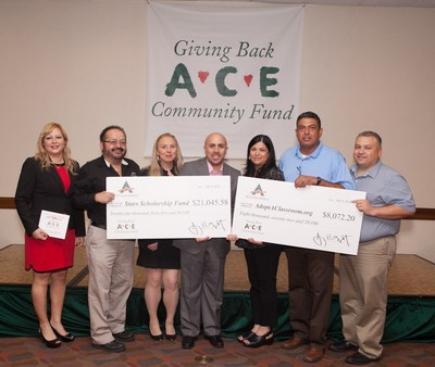 ACE employees present donation checks to AdoptAClassroom.org and Stars. (PRNewsFoto/ACE Cash Express, Inc.)
