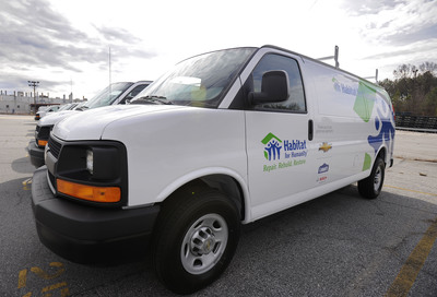 "Habitat for Humanity's first fleet of Habitat Mobile Response Units. Chevrolet donated a total of 24 Express vans, including the 19 C-20 Panel vans that will be used in Habitat for Humanity's ""Repair. Rebuild. Restore."" efforts to help communities recovering from Hurricane Sandy.(PRNewsFoto/Habitat for Humanity International)"