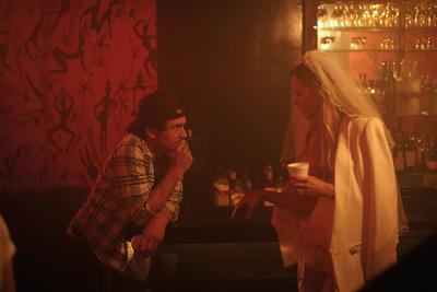 "James Franco & Petra Nemcova discuss direction of Stuart Weitzman ""Walking After Midnight"" social media video while taking a break from filming at Le Baron Nightclub.  (PRNewsFoto/Stuart Weitzman Holdings LLC)"