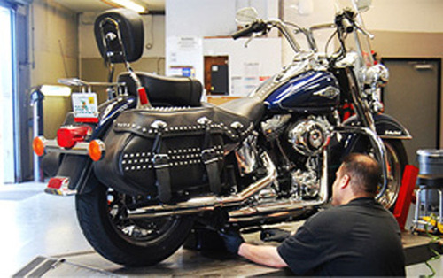 EagleRider technician working in service center.  (PRNewsFoto/EagleRider)
