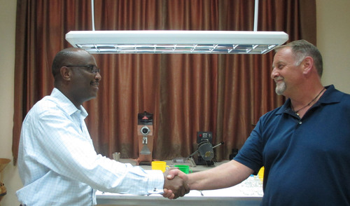 Specialty Coffee Association of America Director Skip Finley Congratulates Aman Adinew, Chief Executive Officer, METAD on Lab Certification May 17 in Addis Ababa, Ethiopia.  (PRNewsFoto/METAD)