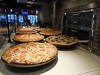 PIZZA HUT UNVEILS NEXT GENERATION RESTAURANT FORMATS. (PRNewsFoto/Pizza Hut) (PRNewsFoto/PIZZA HUT)