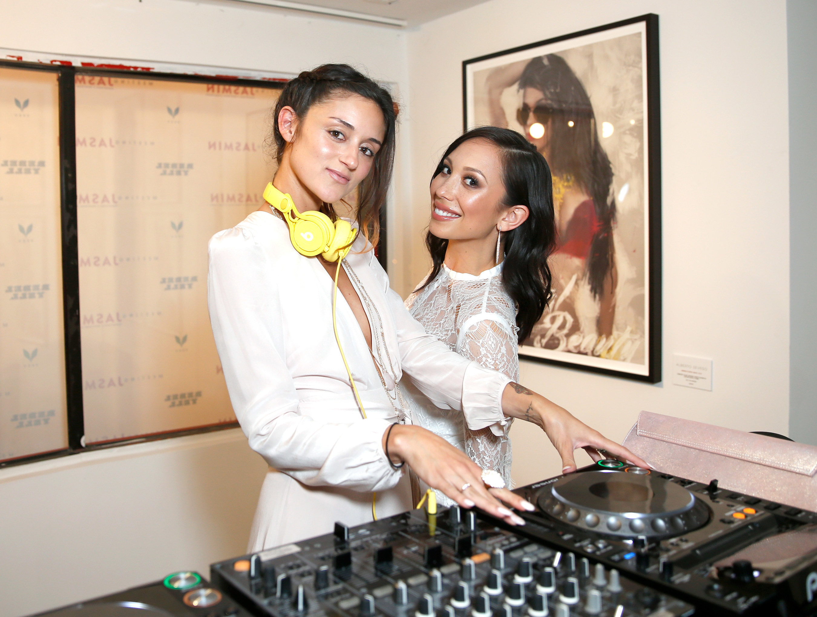 DJ Caroline D'Amore spun an inspired set while friend and Dancing with the Stars alum, Cheryl Burke, grooved to the tunes at the Meeting JASMIN fine art exhibition in Los Angeles, CA.