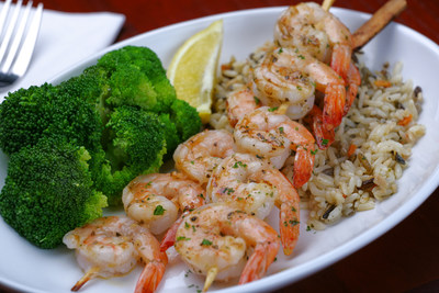 Red Lobster's new Garlic-Grilled Shrimp dinner features two skewers of bigger, better shrimp and is available beginning December 14th.