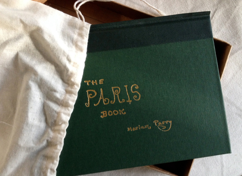 THE PARIS BOOK LIMITED EDITION. The Paris Book by Marian Parry (Un-Gyve Press, Boston) limited edition of 333 signed and numbered by the artist; a hand-bound, cloth-covered book in gold-stamped box and cotton satchel with twenty carefully reproduced watercolours. (PRNewsFoto/Un-Gyve Press)