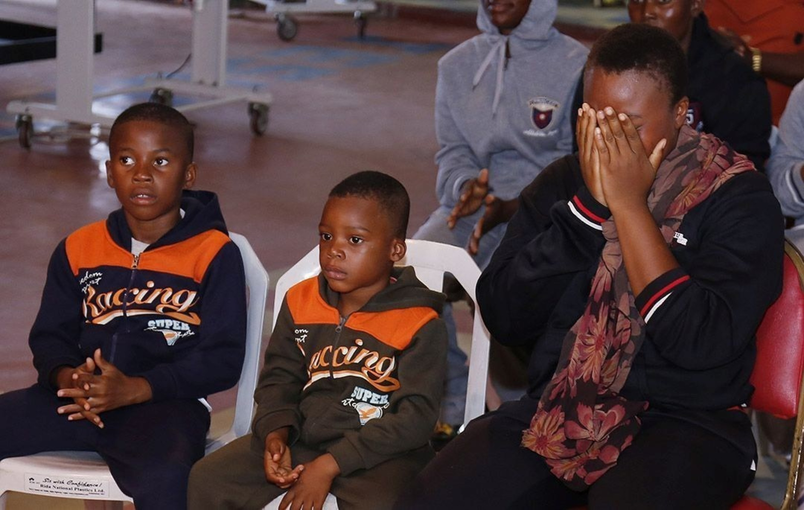 Precious Chioma cries as she recounts the ordeal she passed through with her two sons in their attempt to illegally travel to Europe from Nigeria. She sold all of her possessions to finance the trip but ended up in a Libyan prison after she was caught with her children hiding in suffocating conditions inside a watermelon truck. (PRNewsFoto/Emmanuel TV)