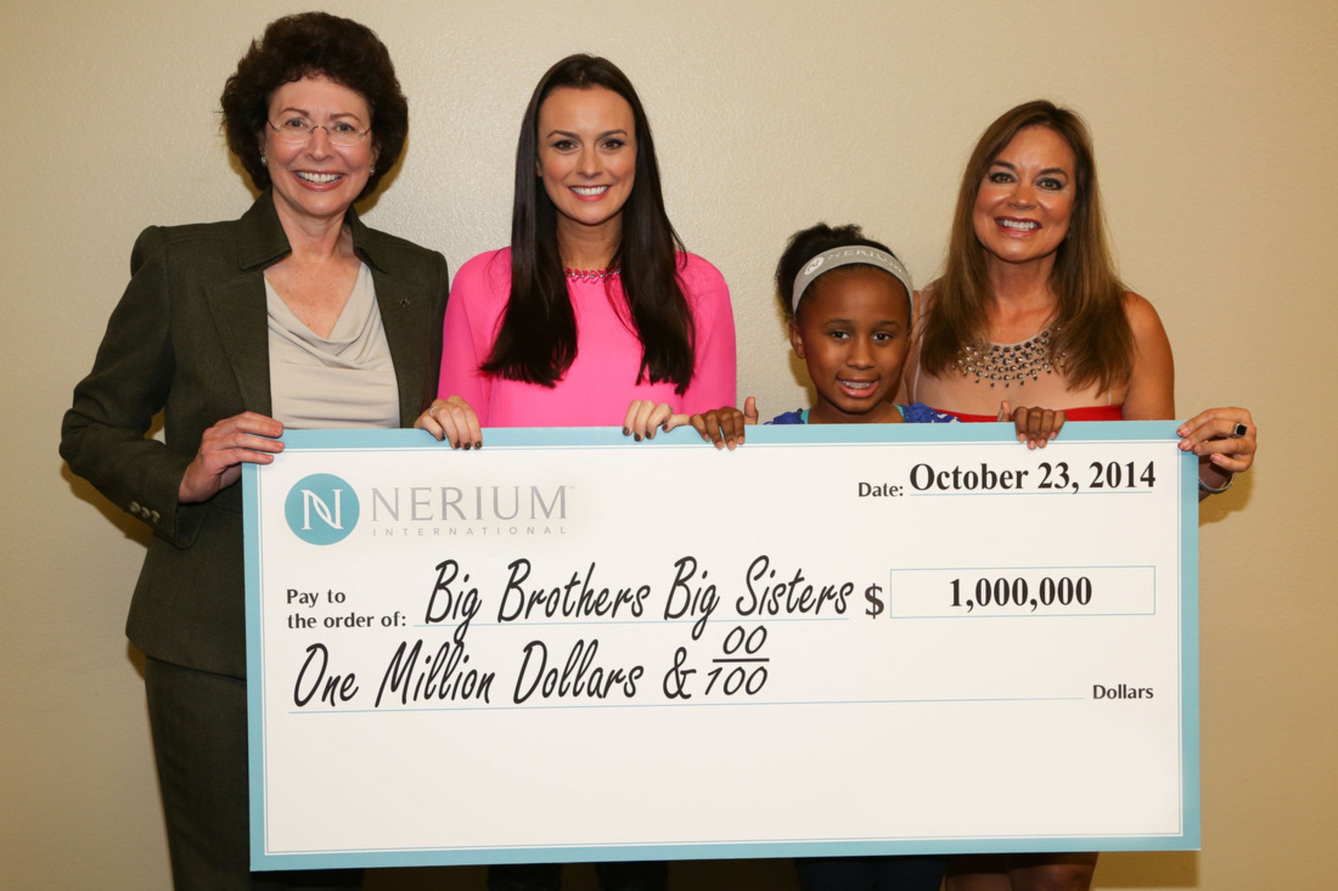 Amber Olson Rourke and Renee Olson, of Nerium International, present Pam Iorio, President and CEO of Big Brothers Big Sisters of America, with a check for $1,000,000.