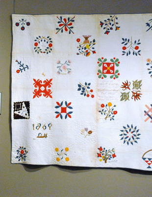 "Part of the Exhibit ""Civil War Period Quilts,"" this is a very fascinating presentation quilt representing the honor and respect for Rev. D.C. McCoy. Daniel C. McCoy served in the 137th Illinois Infantry Volunteers which was organized at Camp Wood, Quincy, Illinois. The regiment was mustered on June 5, 1864 and served for one hundred days. Reverend McCoy was a well-respected pastor for the First Presbyterian Church of Clayton, Illinois located in Adams County. The date acknowledged on this quilt is August 20th, 1869, at The National Quilt Museum.  (PRNewsFoto/National Quilt Museum)"