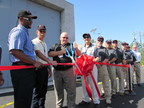 Plant Vogtle 1 and 2 Vice President Keith Taber cuts the ribbon to dedicate the site's new FLEX Dome storage building.