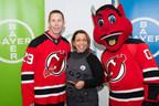 Former Devil, Grant Marshall, and Devils mascot, N.J. Devil, visit Bayer's US headquarters as part of Bayer Fights Cancer on Feb. 26, 2015.