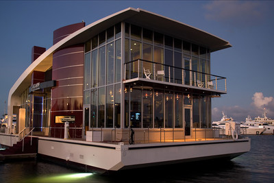 "This one-of-a-kind maritime asset will be sold by Platinum Luxury Auctions on December 11, 2015. Part boat, part office, part luxury entertainment space, the asset, known as ""Domino,"" was one a premier sales and showcase facility for the Lazzara  Yachts company. Details at DominoLuxuryAuction.com."
