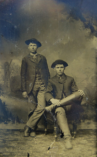 An original tintype photograph of Frank (sitting) and Jesse James (standing) taken just prior to Frank's ...