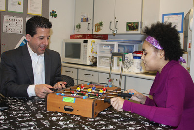 Dr. David L.S. Morales, chief of pediatric cardiothoracic surgery, plays foosball with his patient, 20-year-old Tiernee Gonzalez, the first SynCardia Total Artificial Heart recipient at Cincinnati Children's Hospital Medical Center.  (PRNewsFoto/SynCardia Systems, Inc.)