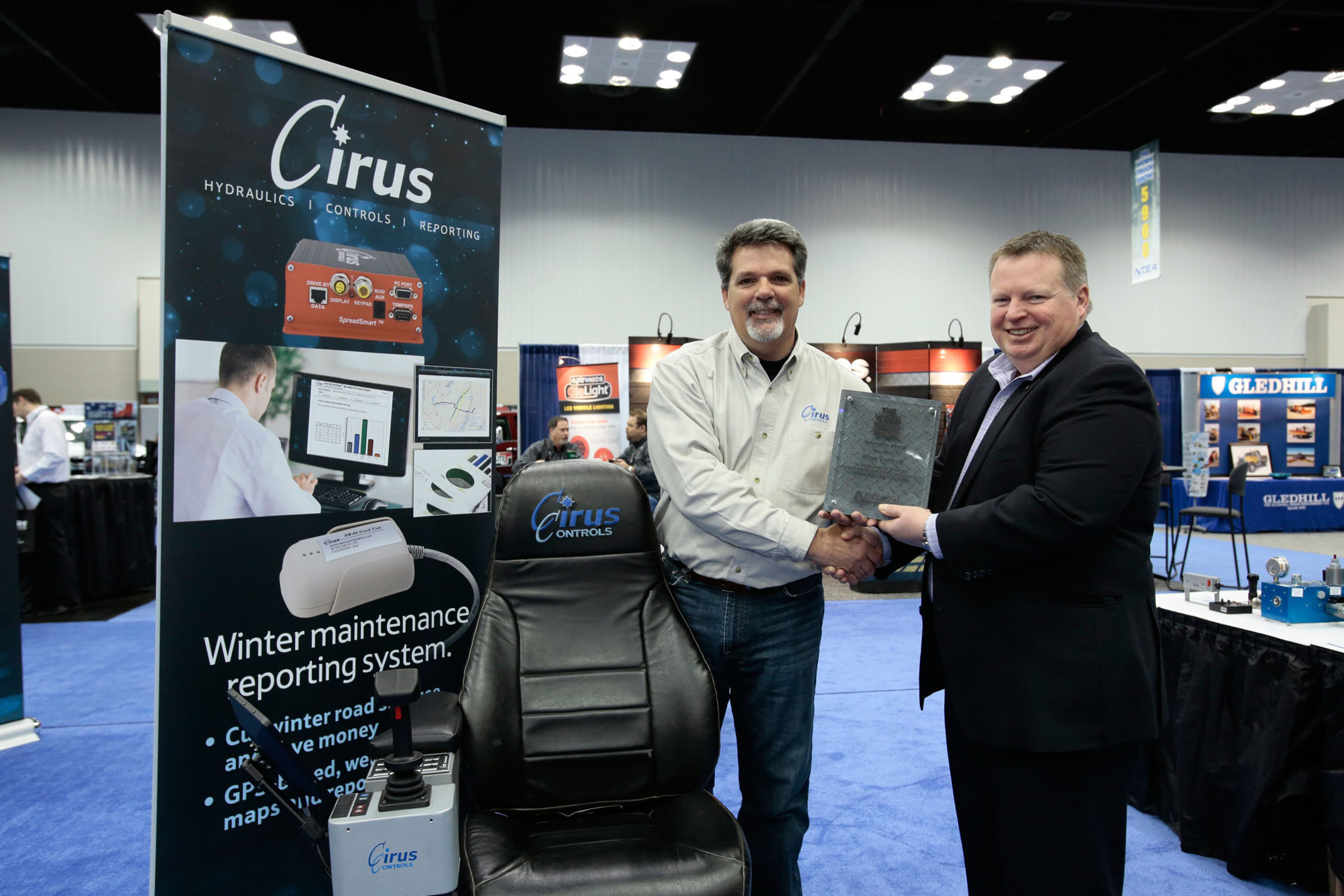 The Work Truck Show(R) 2014 Innovation Award was won by Cirus Controls for its GPS DataSmart(TM) winter maintenance reporting system. Dave McElrone, Cirus Controls western region manager (left), accepted the award from Steve Carey, executive director of NTEA – The Association for the Work Truck Industry (right), last week during The Work Truck Show 2014 at the Indiana Convention Center in Indianapolis, IN. (PRNewsFoto/NTEA) (PRNewsFoto/NTEA)