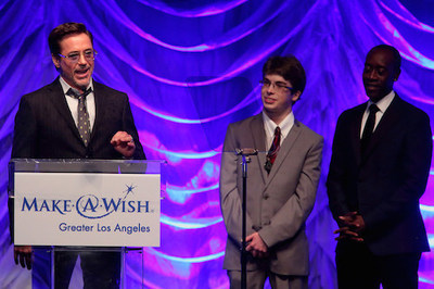 Oscar(R)-nominated actor Don Cheadle and Wish Kid Cameron Fisch (now age 22) presented Robert Downey Jr. with the Shining Star Award for the dozens of wishes that he has granted to children around the world. Downey fulfilled Cameron's wish five years ago when he invited the then 17-year-old, who has a nervous system disorder, to the movie set of The Avengers. Photo Credit: Craig T. Mathew and Greg Grudt/Mathew Imaging