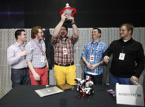 "The Nordstrom team accepts the trophy for best LEGO MINDSTORMS EV3 robot during the ""Build 4 Good"" challenge at Seattle's EMP Museum on Thursday, April 10 2014. Local companies including Amazon, Egencia, Expedia, HTC, Nordstrom, Xbox and zulily built robots that celebrated creative solutions to everyday problems. (PRNewsFoto/LEGO Systems, Inc./Ron Wurzer/AP Images for The LEGO Group) (PRNewsFoto/LEGO SYSTEMS_ INC_)"