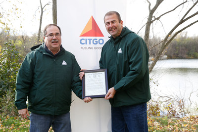 Village of Lemont Mayor Brian Reaves presents Jim Cristman, Vice President and General Manager of the CITGO Lemont Refinery, with a proclamation during the CITGO Lemont Quarry Restoration Project.