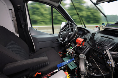 Ford is first automaker to develop robotic technology that drives vehicles during new accelerated high-impact on-road and off-road durability testing.  (PRNewsFoto/Ford Motor Company)
